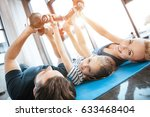 happy family exercising with... | Shutterstock . vector #633468404