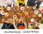 Small photo of Friends dinner table top view. People eat healthy food together, home party