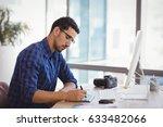 graphic designer using graphic... | Shutterstock . vector #633482066