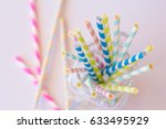 Colorful Paper Straws On White...