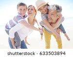 parents giving piggyback ride... | Shutterstock . vector #633503894