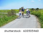happy family riding bikes on... | Shutterstock . vector #633505460