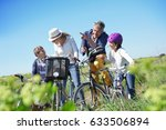 family on a biking day making a ... | Shutterstock . vector #633506894