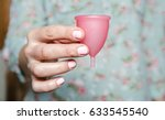 close up of woman hand holding...   Shutterstock . vector #633545540