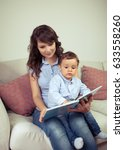 young mother reads a book with... | Shutterstock . vector #633558260
