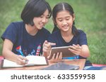 close up of teenage asian girls ... | Shutterstock . vector #633559958