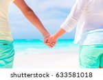 Young Couple Holding Hands At...