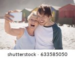 cheerful woman with son taking... | Shutterstock . vector #633585050