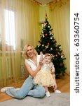 family near new year tree | Shutterstock . vector #63360754