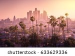 Stock photo beautiful sunset of los angeles downtown skyline and palm trees in foreground 633629336