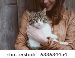Stock photo cute cat portrait with cat owner 633634454