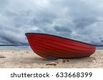 Red Boat Laying On The Sandy...