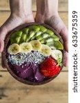 acai bowl in hands | Shutterstock . vector #633675359