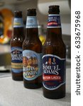 Small photo of Samuel Adams variety of beer bottles sit on a kitchen counter top. Product shot. Named after founding father. Seasonal drink flavor offerings. Illustrative Editorial