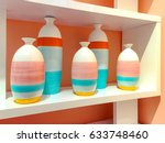 brightly painted ceramic vases... | Shutterstock . vector #633748460