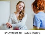 doctor consulting her female... | Shutterstock . vector #633840098