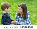 happy mom and son play in the... | Shutterstock . vector #633873104