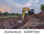 Small photo of View from backhoe was digging a pit in the ground for rainwater,Crawler excavator truck ,Construction digger machine in flat. Backhoe loader, Heavy equipment.