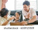 happy asian family having fun... | Shutterstock . vector #633915509