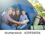 smiling family taking a selfie... | Shutterstock . vector #633936056