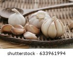 garlic in bamboo basket on... | Shutterstock . vector #633961994