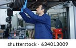 specialist auto mechanic in the ... | Shutterstock . vector #634013009