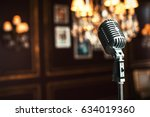 old fashioned microphone | Shutterstock . vector #634019360