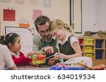 primary school teacher is... | Shutterstock . vector #634019534
