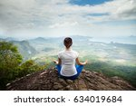 Young Woman Practicing Yoga An...
