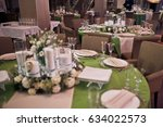 glasses stand on green table in ...   Shutterstock . vector #634022573