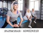 Small photo of Cheerful nice women visiting aerobic classes