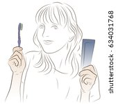a woman is holding a toothbrush ... | Shutterstock .eps vector #634031768