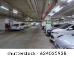 abstract blurred car park... | Shutterstock . vector #634035938