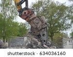 grab crane demolishing a house | Shutterstock . vector #634036160