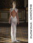 Small photo of NEW YORK, NY - APRIL 21: A model walks the runway at the Berta Runway show during New York Fashion Week: Bridal April 2017 at The Plaza Hotel on April 21, 2017 in New York City.