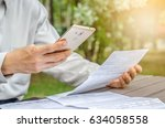 businessman with bills and... | Shutterstock . vector #634058558