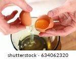 separating egg whites and egg...   Shutterstock . vector #634062320