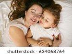 mother and daughter sleeping... | Shutterstock . vector #634068764