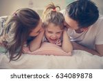happy family with one daughter... | Shutterstock . vector #634089878