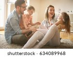 happy family with two daughters ... | Shutterstock . vector #634089968