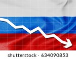 white arrow down on the flag of ... | Shutterstock . vector #634090853