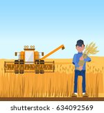 farmer harvesting wheat and... | Shutterstock .eps vector #634092569
