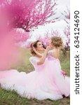mother with her daughter in... | Shutterstock . vector #634124690