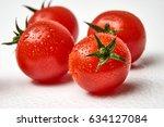 fresh cherry tomato on white...   Shutterstock . vector #634127084