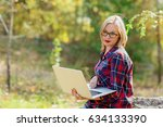 young  girl holds a laptop in... | Shutterstock . vector #634133390