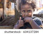 Small photo of Santa Ana, Solomon Islands - March 6th, 2017: A little melanesian kid welcoming visitors with thumb up in Owa Raha (Santa Ana).