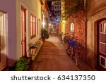 the old narrow medieval street... | Shutterstock . vector #634137350