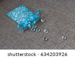 diamonds in a small blue bag | Shutterstock . vector #634203926
