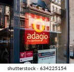 Small photo of STRASBOURG, FRANCE - APR 27, 2017: Adagio hotel facade with city reflection in the glass window. Adagio City Aparthotel is a joint venture launched by Accor Hotels and Pierre & Vacances