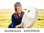 woman in traditional ethnic... | Shutterstock . vector #634239650